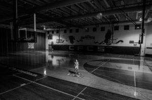 Showing a basketball player in uniform on the court practicing in the Sheridan Bruins Athletics Facilities HMC