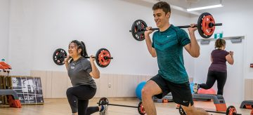 College students doing gym to keep themselves healthy