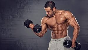 student performing exercise with dumbbells'
