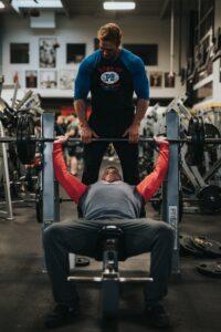 trainer-helping-man